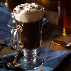 A photo of a delicious cup of Irish coffee. Learn how to make it with Bill's Package store five easy steps and quility liquors.